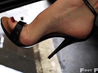 Kelly Space high arched feet in flip flops and high heels parking lot   foothigh heels